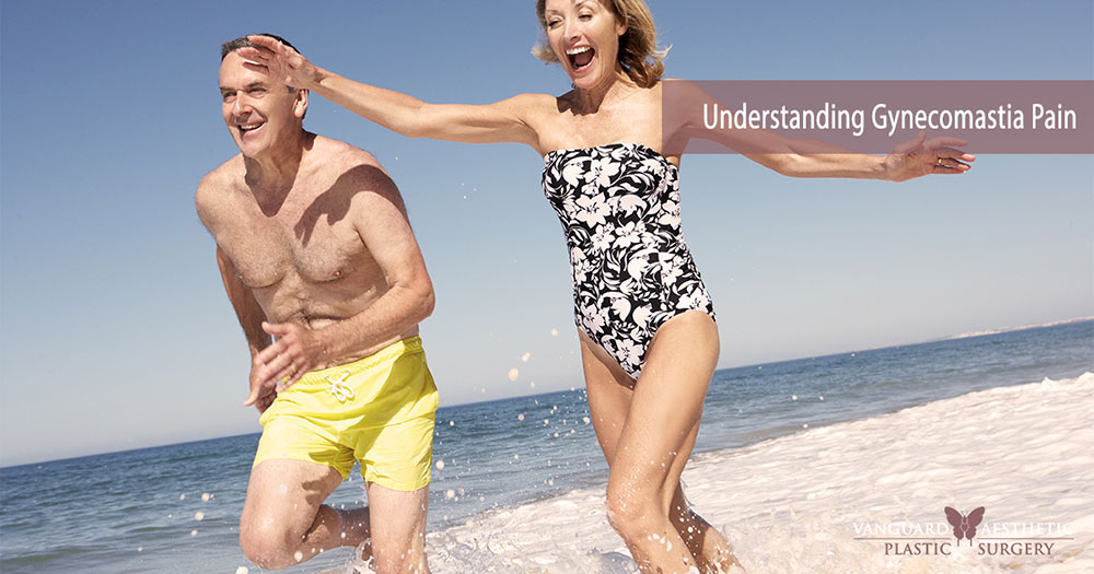 Happy older couple running up the beach, older man and older woman